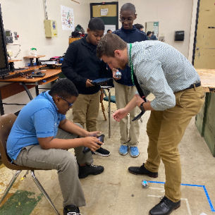 Science teacher Chase Betenson working with students in the pre-engineering class at Heskett