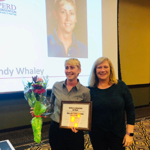 Central PE teacher Wendy Whaley is presented with her award and at the OAHPERD convention.